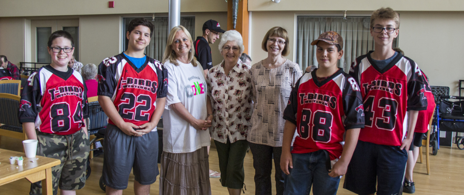 T-Bird football players visit Pembina Lodge