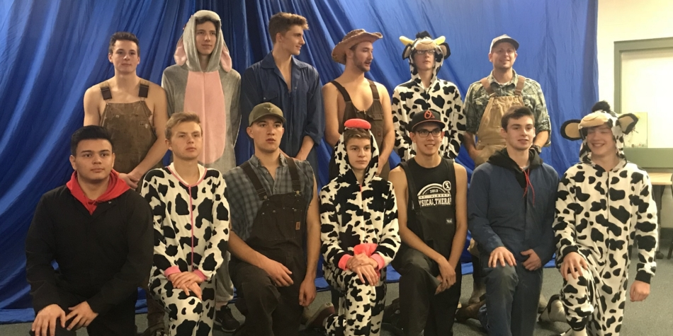 Sr. Boys volleyball farmers with their animals at the Louis St. Laurent tournament
