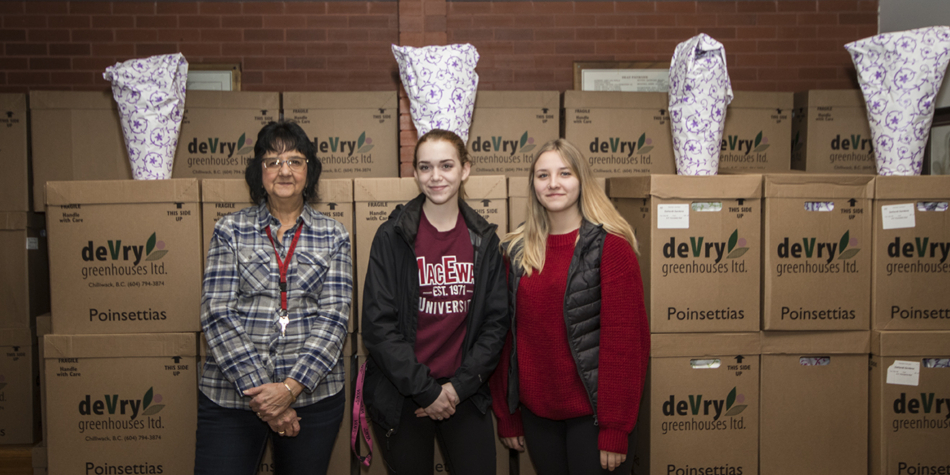 Grads sell over 1000 poinsettias as a fundraiser for convocation