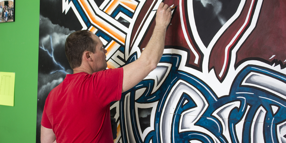 David Scott, Artist in Residence, puts finishing touches on the mural